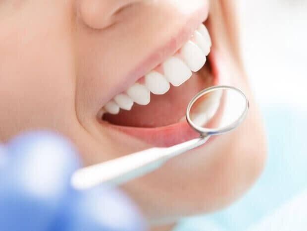 Dentist checking smile