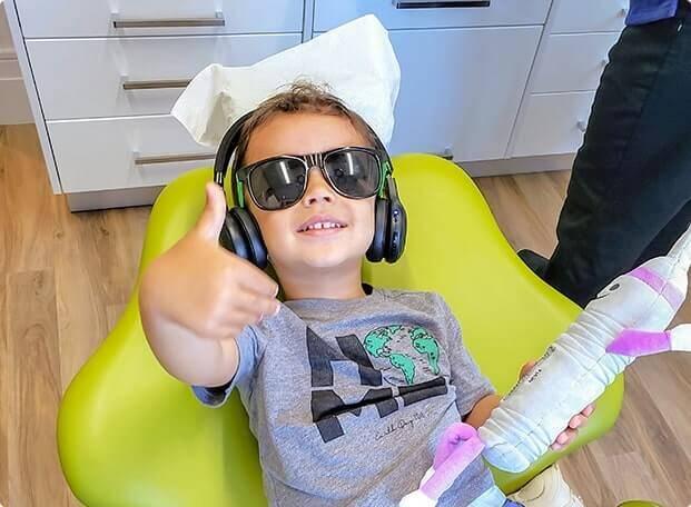 kid smiling on dental chair