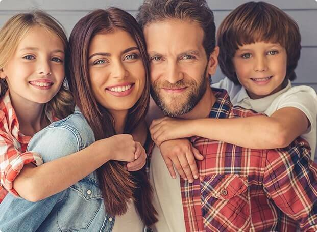 Family smiling for preventive dentistry