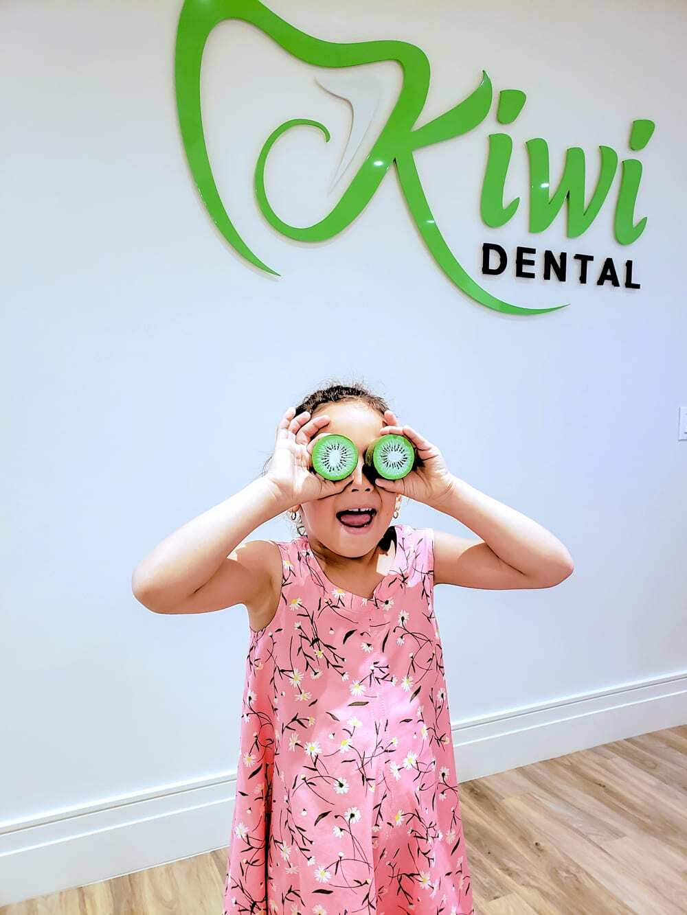 Kid having an awesome time at a dental office