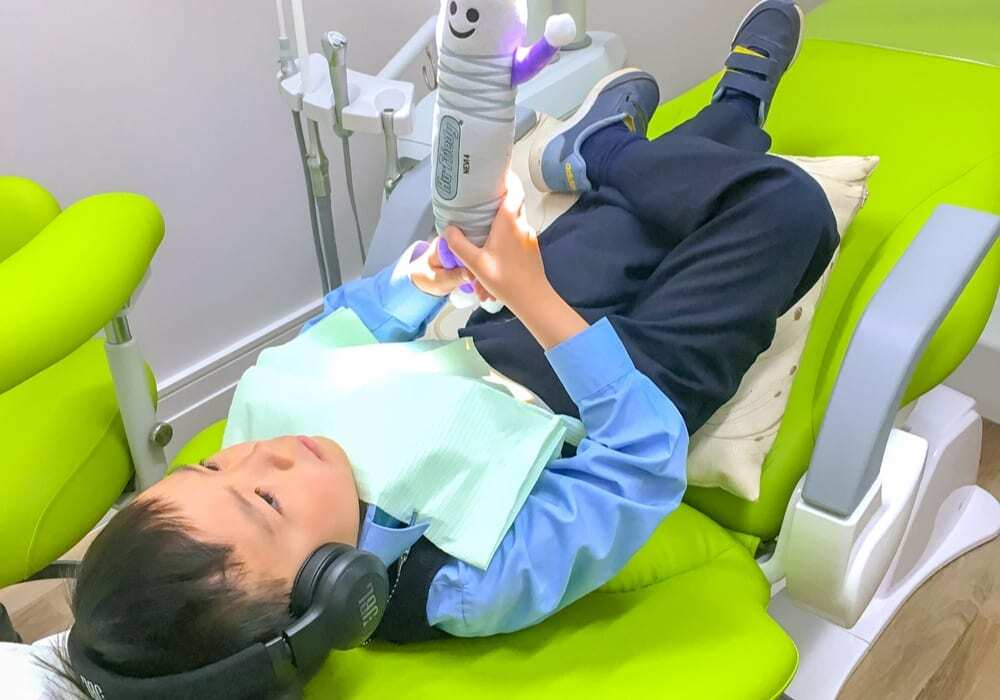 Kid on dental chair