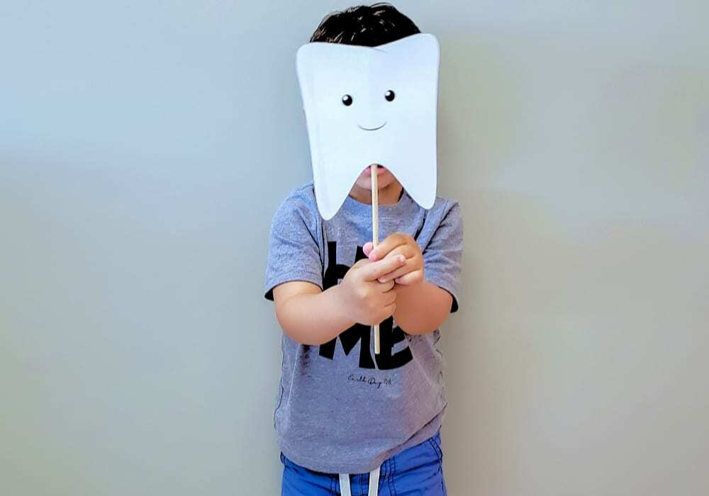 Kid with tooth mask